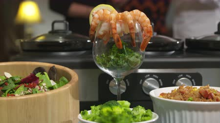 bulaşıklar : Shrimp Cocktail Move Right. camera moves right and spins keeping focus on shrimp cocktail display on a table surrounded by a variety of food dishes