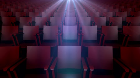 tiyatro : Rows of Movie Seats with Light of Projection Above. rows of empty movie seats with light of a projector flashing above with lens flare Stok Video