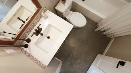 küvet : Generic Bathroom Overhead Lower and Rising in Doorway. a lowering and rising overhead shot of the bathroom in a modern rustic industrial style home. Vanity, toilet and shower