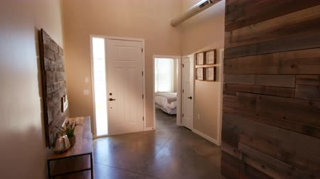 izzók : Rising Home Entrance Hallway with Wood Wall. view looking at the front door of a home entrance way and hallway