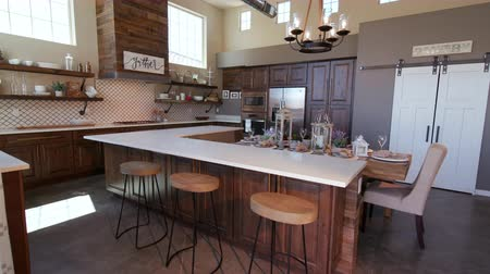 frigorífico : Rising on Modern Kitchen Island with Stools. a loft style rustic industrial kitchen rises to reveal high ceilings