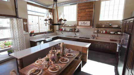 frigorífico : Lowering from High to Show Modern Kitchen and Dining Table. a high shot of a modern rustic industrial kitchen lowering to dining room table low angle Stock Footage