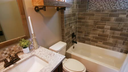 tubérculo : Small Modern Bathroom Lowering to Floor. shot lowers on a new modern bathroom from up high Stock Footage