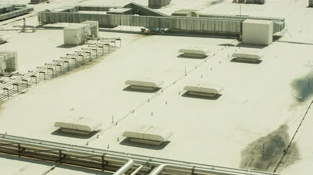 výfuk : Close Up Industrial Roof Panning Left. looking down on an industrial roof with venting, ducts and piping systems