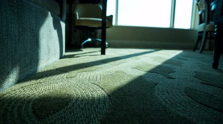 rolety : Hotel Room Low Angle Morning Move Right Blue Tint. a low angle of hotel room floor as view moves to left with bright window in morning Wideo