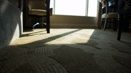 rolety : Hotel Room Low Angle Shades Close Move Right. low angle of hotel room floor as automatic shades and blinds close to darken room as view moves right