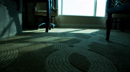 rolety : Hotel Room Low Angle Shades Open Move Left Blue Tint. low angle of hotel room floor as automatic shades and blinds open to reveal morning as view moves left