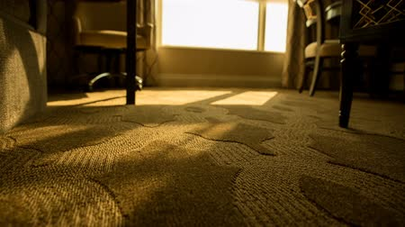 rolety : Hotel Room Low Angle Shades Open Move Right. low angle of hotel room floor as automatic shades and blinds open to reveal morning as view moves right. Orange tint