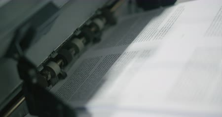 ксерокс : Book Paper Printing Machine Close Up Angle. a close up of paper printed and rolled out