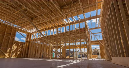 épít : New Construction Framed Home Interior Time-lapse. a time-lapse moves from left to right on the interior of an unfinished new home construction process Stock mozgókép
