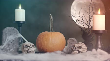 crânio : Halloween Background with Pumpkin Candles and Moon. a background theme for Halloween with a pumpkin, skulls, candles and moon Vídeos