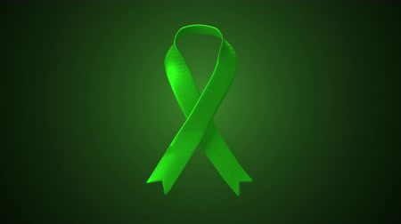 játra : Animated Green Ribbon from Side. an animated ribbon flows in from the side and ties into a green ribbon in the middle of the screen Dostupné videozáznamy