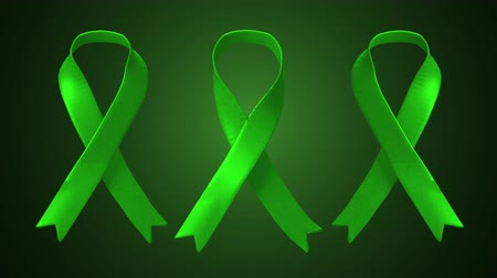 játra : Three Animated Green Ribbons. three animated green ribbons enter into the scene and tie into a ribbon