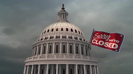 united states : Capital Building and Clouds with Closed Flag Animation. animation of the top of the United States Capital Building with ominous dark clouds background and a waving flag that states, sorry were closed. Luma matte for isolation