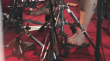 bicí nástroje : Bare Feet Hitting Drum Pedals. a close up shot of feet hitting drum pedals during play