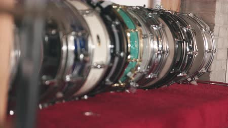 raf : Snare Drums Variety on Shelf. rack focus shot down the line on a variety of snare drums on a shelf