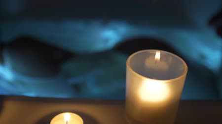küvet : Female Taking a Candlelit Bath on Side Move Right. a slow motion view of a female taking a bath by candle light laying on her side in a seductive pose, focus on foreground bath faucet and candles
