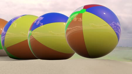 Beach Balls Dropping on Sand Looping Animation. animation of beach balls dropping onto the sand and rolling left in a row. Clip can be looped Dostupné videozáznamy