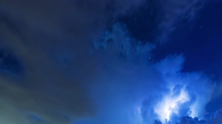 гром : Dramatic Lightning Storm Timelapse of Sky Clouds. a time lapse in the sky of a dramatic lightning storm rolling by