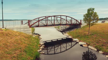 Aerial Fly Over Bridge to Reveal Lake. an aerial flyover a bridge to reveal a lake. Slow motion