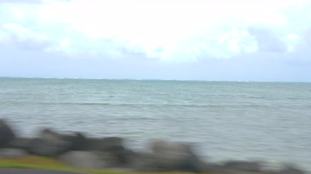 Driving Along Ocean. a passenger driving view looking at the ocean on Oahu island in Hawaii