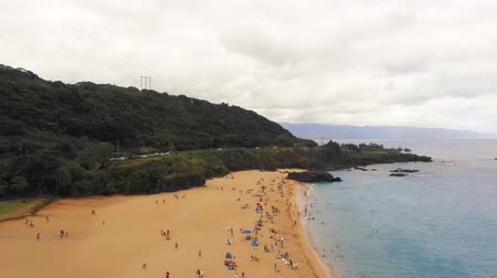 Aerial Beach Shore Pull Back with Rain Drops. aerial view pulls back on the shore of a beach with rain drops starting to fall and people leaving Dostupné videozáznamy