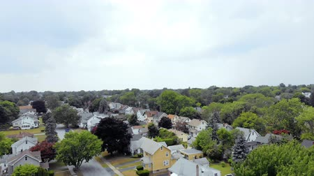 bairro : Aerial Fly Over Suburban Neighborhood. aerial view flying over traditional suburban neighborhood on cloudy day