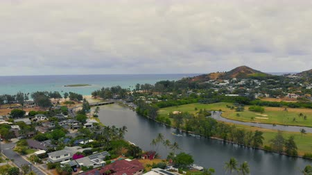 назад : Aerial Pull Back from River in Hawaii. aerial view pulling back from an inlet from the ocean in Kailua Hawaii
