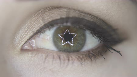 bulva oční : macro of eye with iris closing and star ring light