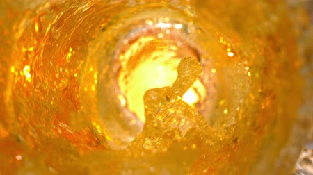 cerveja : Beer pouring into a glass in slow motion tabletop 1080 Vídeos