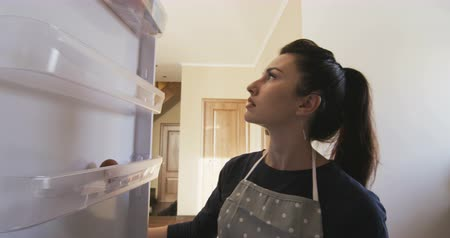 mais : Woman opens an empty fridge and disappointed Stock Footage