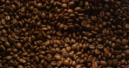 light roast : Coffee Beans Grinding with Light Changing Red Camera Top Shot