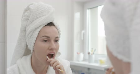 Brushing Teeth Pretty Woman with Towel on Head with a Toothbrush Wideo