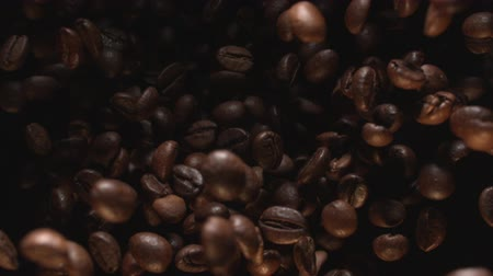 Coffee Beans Flying in Air in Slow Motion at 1500 fps on Black Background