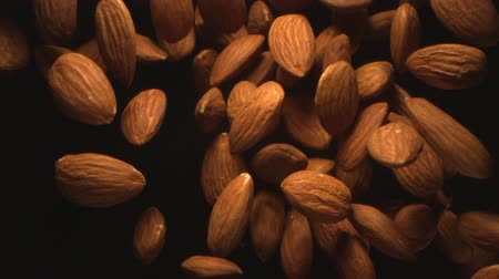 Almond Nuts Flying in the Air in a Free Fall in Slow Motion on Black Background at 1500 fps Wideo