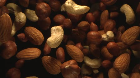 Assorted Nuts Flying in the Air in a Free Fall in Slow Motion on Black Background at 1500 fps