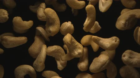 Cashew Nuts Flying in the Air in a Free Fall in Slow Motion on Black Background at 1500 fps