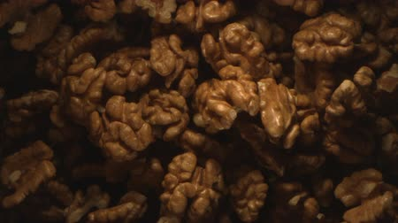 Walnut Nuts Thrown in the Air in High Speed Flying on Black Background at 1500 Fps