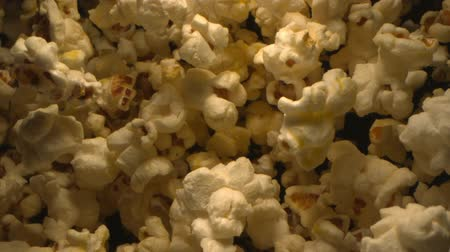 Popcorn Tossed up in the Air Against Black Background an Overhead Shot at 1500 fps