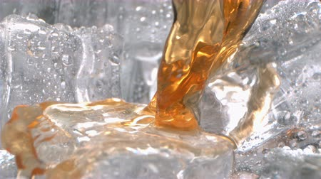 Whiskey Macro is Powered on Ice Inside a Glass in Slow Motion Wideo