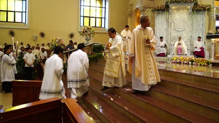 cassock : Laguna, Philippines, January 15, 2013 - Priests gather in the church during mass celebration Stock Footage