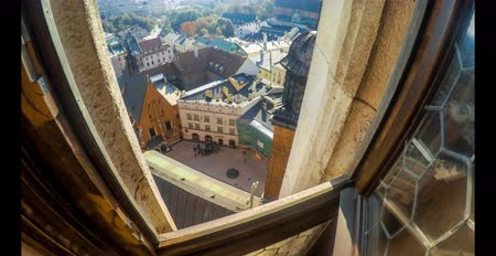 KRAKOW, POLAND: CIRCA 2015: Top view from St. Marys Basilica tower on old crowded streets near market square in the sunny morning. Time lapse video Dostupné videozáznamy