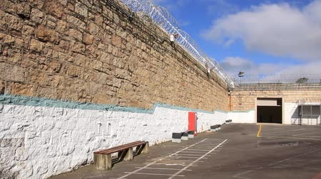 jailed : Prison Jail Gaol razor wire and security Stock Footage