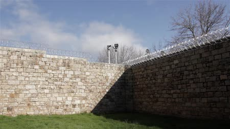 jailed : Prison Jail Gaol yard razor wire and security fence