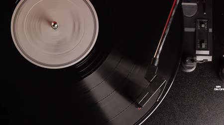 gravar : vinyl record played on vintage record turntable player