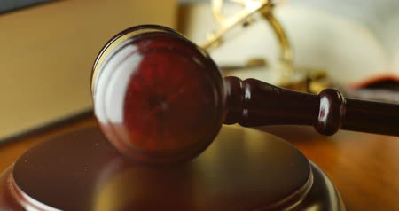law enforcement : Court of law justice magistrate judge gavel and hammer Stock Footage