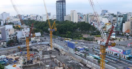 коммерческий : HO CHI MINH  SAIGON, VIETNAM - 2015: building construction site men working Стоковые видеозаписи