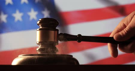 deneme : Judge calling order with hammer and gavel in american court with flag background Stok Video