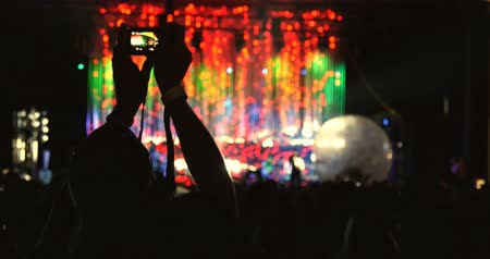 event : Person taking video and photos at concert stage event Stock Footage