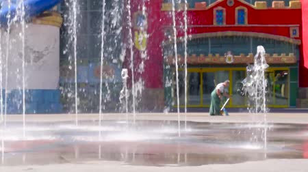 Ukraine, Kharkiv-August 20, 2017: Children ride on scooters near the fountain in the city park Wideo